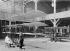 "Painting and varnishing of a triplane in ""Voisin"" workshops. France, 1908. © Jacques Boyer/Roger-Viollet"