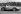 Stirling Moss (né en 1929), pilote automobile britannique, au volant de sa Maserati. Goodwood (Angleterre), 25 septembre 1954. © TopFoto/Roger-Viollet
