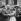 Françoise Arnoul, actrice française, Jean Renoir, cinéaste français, Gene Kelly, acteur américain et Charles Vanel, acteur français. Cannes (Alpes-Maritimes), 1955. © Boris Lipnitzki / Roger-Viollet