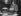 Exposition de machines à écrire en Angleterre : l'une des premières machines et une machine Remington Noiseless (1925). © Roger-Viollet
