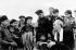 Le président vietnamien Hô Chi Minh (1890-1969) entouré de paysans de la commune de Hung Sou (province de Bac Thai), 1954. © Roger-Viollet