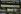 """Quai de la Mégisserie. """"Rue de la Monnaie, place de l'Ecole. Détail : panneau de la Samaritaine par Frantz Jourdain (1847-1935),1905"""". Photographie d'André Bondil (1918-2009). Diapositive. Paris (Ier arr.), 9 juin 1986. Paris, bibliothèque de l'Hôtel de Ville. © André Bondil / BHdV / Roger-Viollet"""