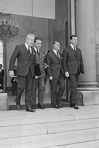 """Events of May-June 1968. Meeting of the Council of Ministers. Henri Duvillard (1910-2001), Minister for War Veterans, Edmond Michelet (1899-1970), State Minister, and Robert Boulin (1920-1979), Minister for the Public Service, leaving Matignon. Paris (VIth arrondissement), on June 12, 1968. Photograph by Jean Laborie, from the collections of the French newspaper """"France-Soir"""". Bibliothèque historique de la Ville de Paris. © Jean Laborie / Fonds France-Soir / BHVP / Roger-Viollet"""