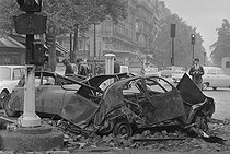 "May-June 1968 events. Damage after the second night of the barricades, boulevard Saint-Germain. Paris (Vth-VIth arrondissements), on May 28, 1968. Photograph by Jacques Boissay, from the collections of the French newspaper ""France-Soir"". Bibliothèque historique de la Ville de Paris. © Jacques Boissay / Fonds France-Soir / BHVP / Roger-Viollet"