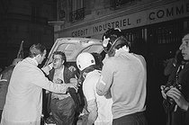"Events of May-June 1968. Demonstration in the Latin Quarter. Paramedics trying to evacuate the people wounded during violent altercations on the boulevard Saint-Michel. Paris (Vth-VIth arrondissement), on May 23, 1968. Photograph by Claude Champinot from the collections of the French newspaper ""France-Soir"". Bibliothèque historique de la Ville de Paris. © Claude Champinot / Fonds France-Soir / BHVP / Roger-Viollet"