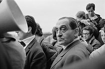 """Events of May-June 1968. Pierre Mendès France (1907-1982), French politician, during a rally at the Charléty stadium, organized by the National Union of Students of France (Union nationale des étudiants de France, UNEF), the National Federation of Education (Fédération de l'éducation nationale, FEN) and the Unified Socialist Party (Parti socialiste unifié, PSU). Paris (XIIIth arrondissement), on May 27, 1968. Photograph by Daniel Lapied, from the collections of the French newspaper """"France-Soir"""". Bibliothèque historique de la Ville de Paris. © Daniel Lapied / Fonds France-Soir / BHVP / Roger-Viollet"""