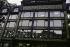 """Quai de la Mégisserie. """"Rue de la Monnaie. Façade de la Samaritaine, panneaux des rayons """"Travail, Chasse etc"""""""". Photographie d'André Bondil (1918-2009). Diapositive. Paris (Ier arr.), 23 novembre 1988. Paris, bibliothèque de l'Hôtel de Ville. © André Bondil / BHdV / Roger-Viollet"""