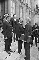 """Events of May-June 1968. French Council of Ministers. Robert Boulin (1920-1979), new Minister of the Civil Service, Jacques Chirac (born in 1932), Secretary of State for Economy and Finance, and Georges Pompidou (1911-1974), French Prime Minister. Paris (VIIth arrondissement), Matignon, on June 5, 1968. Photograph by Michel Robinet, from the collections of the French newspaper """"France-Soir"""". Bibliothèque historique de la Ville de Paris. © Michel Robinet / Fonds France-Soir / BHVP / Roger-Viollet"""
