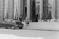 """Events of May-June 1968. Meeting of the French Council of Ministers during a cabinet reshuffle. Yvonne de Gaulle (1900-1978), wife of President Charles de Gaulle, leaving Matignon. Paris (VIIth arrondissement), on May 31, 1968. Photograph by Daniel Lapied, from the collections of the French newspaper """"France-Soir"""". Bibliothèque historique de la Ville de Paris. © Daniel Lapied / Fonds France-Soir / BHVP / Roger-Viollet"""