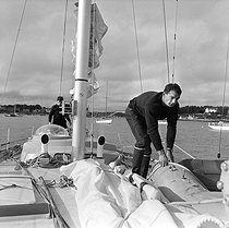 "Eric Tabarly (1931-1998), French sailor, on the deck of his boat ""Pen Duick III"", with a member of his crew : Yves Guégan. La Trinité-sur-Mer (France), 1968. © Jacques Cuinières / Roger-Viollet"
