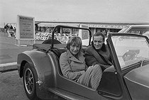 "Parisians in Deauville. Françoise Sagan (1935-2004), French woman of letters, convalescent, with Jean Chevrier (1915-1975), French actor. Deauville (France), on March 19, 1972. Photograph by Jean-Yves Grandemange, from the collections of the French newspaper ""France-Soir"". Bibliothèque historique de la Ville de Paris. © Jean-Yves Grandemange / Fonds France-Soir / BHVP / Roger-Viollet"