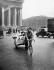 World War II. Bridal couple in a cycle-taxi, place de la Madeleine. Paris (VIIIth arrondissement), December 1941. © LAPI / Roger-Viollet