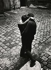 Couple kissing in a courtyard, rue Elzévir. Paris (IIIrd arrondissement), Marais district, 1967. Photograph by Léon Claude Vénézia (1941-2013). © Léon Claude Vénézia / Roger-Viollet