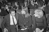 "Jean-Marie Perier (born in 1940), Françoise Hardy (born in 1944) and Sylvie Vartan (born in 1944), attending a performance of the Surfs, pop music band from Madagascar. Paris, on December 12, 1963. Photograph by André Grassart (born in 1935), from the collections of the newspaper ""France Soir"". Bibliothèque historique de la Ville de Paris. © André Grassart / BHVP / Roger-Viollet"