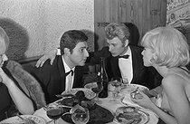 "Johnny Hallyday (1943-2017), Sylvie Vartan (born in 1944) and Richard Anthony (1938-2015), French singers, during the ""Olympia 64"" tour. France, 1964. Photograph by André Grassart (born in 1935), from the collections of the newspaper ""France Soir"". Bibliothèque historique de la Ville de Paris. © André Grassart / BHVP / Roger-Viollet"