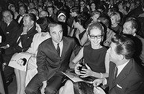 "Charles Aznavour (1924-2018), Armenian-born French singer-songwriter and actor, and Jean Lefebvre (1919-2004), French actor, attending a concert of Trini Lopez (born in 1937), American musician, at the Olympia. Paris on August 22, 1964. Photograph by André Grassart (born in 1935), from the collections of the newspaper ""France-Soir"". Bibliothèque historique de la Ville de Paris. © André Grassart / BHVP / Roger-Viollet"
