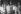 """Verhille, Marc (19..-….) ; Mesnildrey, Raymond (19..-….). """"Plaque Bi-millénaire de Paris, Johnny Hallyday : 111"""". Chirac, Jacques (1932-….) ; Hallyday, Johnny (1943-2017) ; Renaud, Line (1928-….) ; Chirac, Bernadette (1933-….) ; Carlos (1943-2008) ; Lefebvre, Jean (1919-2004) ; Barbelivien, Didier (1954-….). Paris (4e) ; Hôtel de ville. photographie négative n. et b. sur support polyester. 29 mai 1985. Paris, bibliothèque de l'Hôtel de Ville. © Mesnildrey,Verhille / BHdV / Roger-Viollet"""