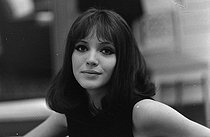 "Anna Karina (1940-2019), Danish-born French actress, singer and writer, during the shooting of ""Alphaville, une étrange aventure de Lemmy Caution"", film by Jean-Luc Godard, January 1965. Photograph by André Grassart (born in 1935), from the collections of the French newspaper ""France-Soir"". Bibliothèque historique de la Ville de Paris. © André Grassart / BHVP / Roger-Viollet"