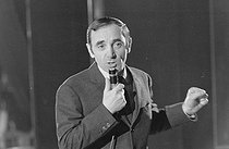 """Charles Aznavour (1924-2018), Armenian-born French singer-songwriter and actor, on January 15, 1965. Photograph by André Grassart (born in 1935), from the collections of the newspaper """"France-Soir"""". Bibliothèque historique de la Ville de Paris. © André Grassart / BHVP / Roger-Viollet"""