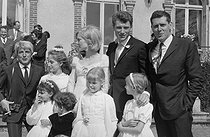 "Wedding of Sylvie Vartan (born in 1944) and Johnny Hallyday (1943-2017), French singers. The newlyweds leaving the town hall after the civil ceremony, surrounded by young wedding attendants and guests. Loconville (France), on April 12, 1965. Photograph by André Grassart (born in 1935), from the collections of the newspaper ""France Soir"". Bibliothèque historique de la Ville de Paris. © André Grassart / BHVP / Roger-Viollet"