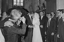 "Wedding of Sylvie Vartan (born in 1944) and Johnny Hallyday (1943-2017), French singers. The newlyweds kissing during the religious ceremony at the Loconville church (France), on April 12, 1965. Photograph by André Grassart (born in 1935), from the collections of the newspaper ""France Soir"". Bibliothèque historique de la Ville de Paris. © André Grassart / BHVP / Roger-Viollet"