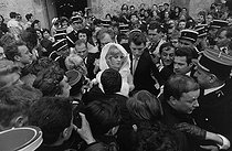 "Wedding of Sylvie Vartan (born in 1944) and Johnny Hallyday (1943-2017), French singers. The newlyweds greeted by the crowd waiting for them after the religious ceremony at the Loconville church (France), on April 12, 1965. Photograph by André Grassart (born in 1935), from the collections of the newspaper ""France Soir"". Bibliothèque historique de la Ville de Paris. © André Grassart / BHVP / Roger-Viollet"