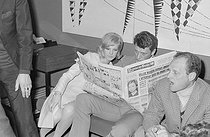 "Wedding of Sylvie Vartan (born in 1944) and Johnny Hallyday (1943-2017), French singers. The newlyweds reading a copy of the French newspaper ""France-Soir"" at the Orly airport, before leaving on honeymoon, on April 12, 1965. Photograph by André Grassart (born in 1935), from the collections of the newspaper ""France Soir"". Bibliothèque historique de la Ville de Paris. © André Grassart / BHVP / Roger-Viollet"