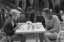 "Wedding of Sylvie Vartan (born in 1944) and Johnny Hallyday (1943-2017), French singers. The newlyweds having breakfast during their honeymoon at the Canary Islands, on April 18, 1965. Photograph by André Grassart (born in 1935), from the collections of the newspaper ""France Soir"". Bibliothèque historique de la Ville de Paris. © André Grassart / BHVP / Roger-Viollet"