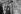 """Guy Bedos (1934-2020) and Sophie Daumier (1936-2003), French actors, at the Foire du Trône fun fair. Paris (12th arrondissement), April 17, 1965. Photograph from the collections of the French newspaper """"France-Soir"""". Bibliothèque historique de la Ville de Paris. © BHVP / Roger-Viollet"""