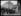 """excelsior. Les tanks britanniques devant la gare de Düsseldorf dans le cadre de l'occupation alliée de la rive droite du Rhin, l'une des clauses du traité de Versailles signé en 1919. Mardi 8 mars 1921. Photographie du journal """"Excelsior"""". 19210308. © Excelsior – L'Equipe / Roger-Viollet"""