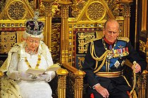 pa-news-old-20140604-163943-politicsspeech163817.jpg. Ray Collins/The Sun. State Opening of Parliament 2014. Queen Elizabeth II sits alongside the Duke of Edinburgh as she delivers her speech in the House of Lords during the State Opening of Parliament at the Palace of Westminster in London. 20140604. © Ray Collins / PA Archive / Roger-Viollet