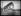 """excelsior. Le pont en construction de Saint-Pierre-du-Vauvray (Eure), traversant la Seine, détruit par une tempête. Mercredi 8 mars 1922. Photographie du journal """"Excelsior"""". 19220308. © Excelsior – L'Equipe / Roger-Viollet"""