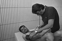 "Tour de France 1976. Raymond Poulidor (1936-2019), French racing cyclist, during his medical examination before the start of the Tour, on June 23, 1976. Photograph by Bernard Charlet, from the collections of the French newspaper ""France-Soir"". Bibliothèque historique de la Ville de Paris. © Bernard Charlet / BHVP / Roger-Viollet"