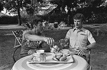 "Tour de France 1976. Raymond Poulidor (1936-2019) and Bernard Thévenet (born in 1948), French racing cyclists, during a rest day. Divonne-les-Bains (France), on July 3rd, 1976. Photograph by Bernard Charlet from the collections of the French newspaper ""France-Soir"". Bibliothèque historique de la Ville de Paris. © Bernard Charlet / BHVP / Roger-Viollet"