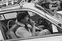"Tour de France 1985. Bernard Tapie (born in 1943), French businessman and politician, aboard a car during the 8th stage from Sarrebourg to Strasbourg (France), on July 6, 1985. Photograph by Bernard Charlet, from the collections of the French newspaper ""France-Soir"". Bibliothèque historique de la Ville de Paris. © Bernard Charlet / BHVP / Roger-Viollet"