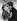 """Betty Furness (1916-1994) et Dennis Morgan (1908-1994), acteurs américains, s'entraînant au baiser de cinéma avec des masques de protection pendant une épidéme de grippe. Hollywood (Californie, Etats-Unis), 1937. Photographie publiée dans """"Die Gruene Post"""". © Ullstein Bild / Roger-Viollet"""