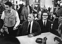 """Georges Pompidou (1911-1974), then Prime Minister and candidate for the French presidential elections, and Jacques Chirac (1932-2019), then Secretary of State, drinking some beers in the Alsatian tavern """"L'ours blanc"""", at the end of the """"Congrès UJP"""". Strasbourg (Alsace, France), 12 April 1969. Photograph by André Perlstein (born in 1942). © André Perlstein / Roger-Viollet"""