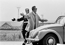 """Jacques Tati (1907-1982), French film-maker, actor and cult scriptwriter of French cinéma. Shooting of the film """"Trafic"""" released in 1971. Amsterdam (Netherlands), 9 July 1970. Photograh by André Perlstein (born in 1942). © André Perlstein / Roger-Viollet"""