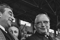 Georges Pompidou (1911-1974), Prime Minister of Charles de Gaulle, with Joseph Comiti (1920-2000), Minister of Sport, attending a rugby match of the Five Nations Championship: France – Wales. Score: 8-8. Yves du Manoir Stadium. Colombes, 22 March 1969. Photograph by André Perlstein (born in 1942). © André Perlstein / Roger-Viollet