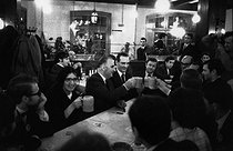 """Georges Pompidou (1911-1974), Prime Minister and candidate for the French presidential elections, and Jacques Chirac (1932-2019), Secretary of State, drinking some beers in the Alsatian tavern """"L'ours blanc"""", at the end of the Congrès UJP (Union des jeunes pour le progrès), French Gaullist movement. Strasbourg (France), 12 April 1969. Photograph by André Perlstein (born in 1942). © André Perlstein / Roger-Viollet"""
