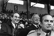 Joseph Comiti (1920-2000), Minister of Sports, and Georges Pompidou (1911-1974), Prime Minister of Charles de Gaulle, attending a rugby match of the Five Nations Championship: France – Wales. Score: 8-8. Colombes (France), Yves du Manoir Stadium, 22 March 1969. Photograph by André Perlstein (born in 1942). © André Perlstein / Roger-Viollet