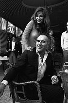 """Michel Piccoli (1925-2020), French actor, with Léa Massari (born in 1933), French actress, at the Cannes Film Festival for the présentation of the film """"Les Choses de la vie"""" (The Things of Life), by Claude Sautet. Cannes (Alpes-Maritimes, France), 11 May 1970. Photograph by André Perlstein (born in 1942).  © André Perlstein / Roger-Viollet"""