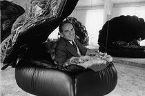 Pierre Cardin (né en 1942), Italian-born French fashion designer and businessman, lying on a turtle-shaped couch he created, at the head office of his company, rue du Faubourg Saint-Honoré. Paris (VIIIth arrondissement), 2 July 1977. Photograph by André Perlstein (born in 1942). © André Perlstein / Roger-Viollet