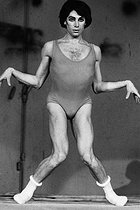 """Paolo Bortoluzzi (1938-1993), Italian dancer and choreographer, at a performance of """"Nomos Alpha"""", choreographed by Maurice Béjart (1927-2007) at the 6th Festival of contemporary art of Royan. Royan (Charente-Maritime, France), 28 March 1969. Photograph by André Perlstein (born in 1942). © André Perlstein / Roger-Viollet"""