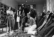 Yves Saint-Laurent (1936-2008), French fashion designer, costume designer and businessman, preparing his 1977 collection with his staff, in his workshop, avenue Marceau. Paris (XVIth arrondissement), 1977. Photograph by André Perlstein (born in 1942). © André Perlstein / Roger-Viollet