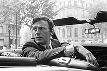 Jean-Louis Trintignant (born in 1930), French actor and film director, in a cabriolet, on the boulevard Saint-Germain. Paris (VIth arrondissement), 1969. Photograph by André Perlstein (born in 1942). © André Perlstein / Roger-Viollet