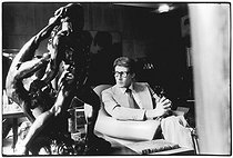 Yves Saint-Laurent (1936-2008), French dress designer, costume designer and businessman, at his house, rue de Babylone, surrounded by his personal items. Paris (VIIth arrondissement), 1977. Photograph by André Perlstein (born in 1942). © André Perlstein / Roger-Viollet