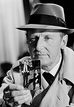 """Bourvil (1917-1970), French actor and singer, during the shooting of the film """"Le Cercle rouge"""" (The Red Circle), by Jean-Pierre Melville. France, January 1970. Photograph by André Perlstein (born in 1942). © André Perlstein / Roger-Viollet"""