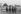 Equipe de police pendant les 24 heures du Mans. Photographie d'André Perlstein (né en 1942). France, 16 juin 1970. © André Perlstein / Roger-Viollet