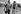 Raymond Poulidor (1936-2019), coureur cycliste français et Jean-François Khan (né en 1938), journaliste et essayiste français, sur le Tour de France. Photographie d'André Perlstein (né en 1942). Juillet 1970. © André Perlstein / Roger-Viollet